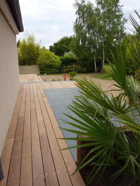 Dallage en pierre et terrasses bois paysagiste sur nantes for Agrandir terrasse bois